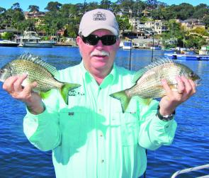 The author with a couple of bream caught on the surface with Lucky Craft NW Pencils over the weed beds near Costens Point, Port Hacking.