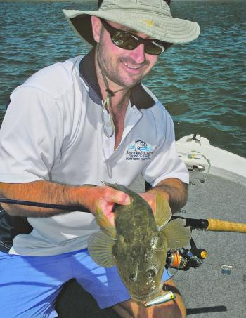 Rob Payne with a flathead caught on a popper.