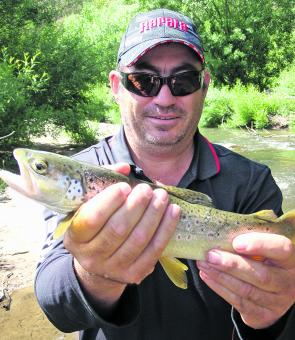 Jamie Robinson with a small stream brown trout. Fishing the smaller creeks is a great way of avoiding the summer crowds, and most trout are more then willing to smash lures and dry flies.