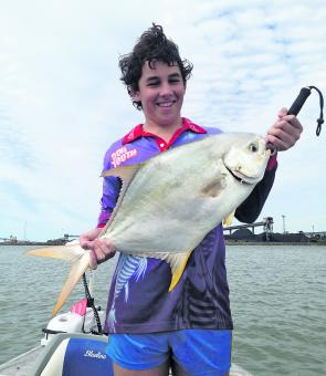Jordon Wills with a very nice permit caught at the mouth of a local creek.
