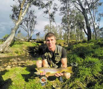 Martin tucker braved the heat and caught this brown trout by staying close to its tree-shaded pool.