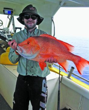Chris Lucas with a solid red emperor from Karamea.