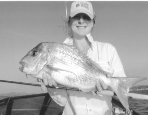 Trudi Badullovich scored this stunning 3.9kg snapper on plastic on her first cast ever. She then backed it up with another 2.6kg red just minutes later.