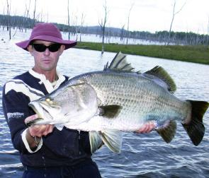 Johnny Mitchell holds up a 98cm barramundi but not for long – they are heavy fish!