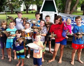 The kids from The Treehouse Tavern Family Fishing Club with a fantastic catch from their May competition.