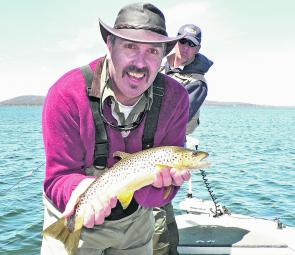 Fabulous Phill Jones with a dry fly caught brown trout from the deep water in Great Lake.