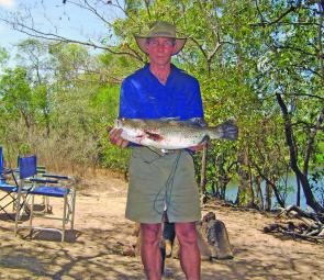 Wayne Brennan with a barra caught walking the bank. Just behind him is where a large crocodile attacked something early one evening during our stay.