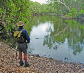 Wayne fishing a hole in the Normanby River. He could have been a little further back from the water's edge but as the water was shallow he was relatively safe. There is debris in the water near the edge, so he was watching for any sign of movement. Also n