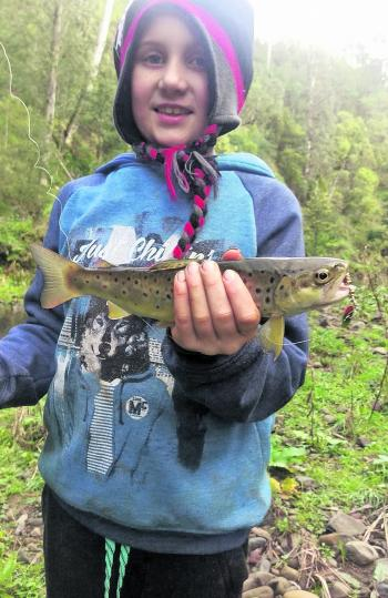 Ryder Thompson with a beautiful brown trout that took a liking to his spinner.