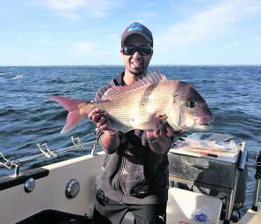 Aaron Sammut with a nice snapper taken out from Black Rock.
