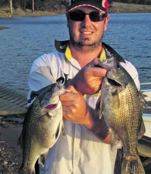 Ross Ferguson of Sydney with two nice bass caught at St Clair working plastics off the bank in the Carrowbrook Reach.