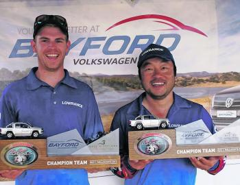 Team We Flick Fishing's Tom McIntosh and Charlie Saykao display their first place trophies.
