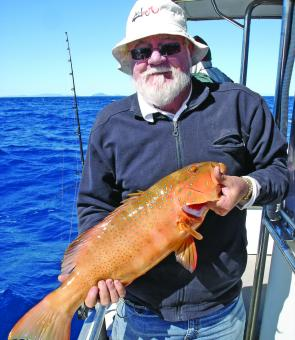 Townsville angler Ian Martin with a bar cheek coral trout.