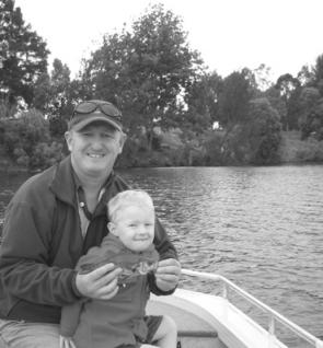 The author with son Nathan and his first bass. Even a 22cm fish can create indelible memories.