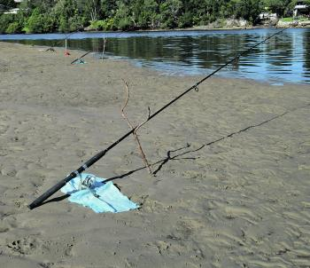 The 'set and forget' technique can work in calm water of estuaries but protect your spinning reels from the sand.