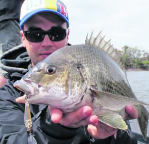 Paul Malov with a solid Tambo bream taken on a hardbody lure.