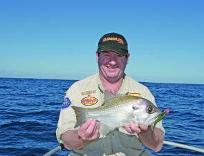 Steve Bain with a Pearl Perch from Smith Reef caught on a watermelon coloured Gambler shad. We love the pearlies at this size, one fish per person on the plate.