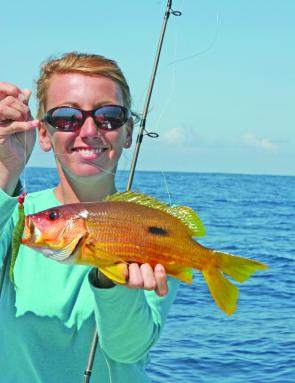 The author Kim with a keeper Moses perch from Smith's Reef caught on a Gambler Watermelon 5