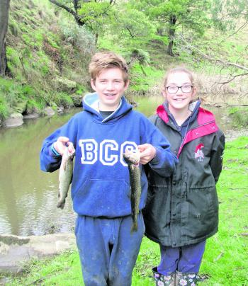 Ben and Chloe Cornford with a couple of brown trout at the season opening.