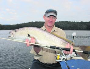 Tim with a solid plastic-caught 87cm jewie that was released to fight another day.