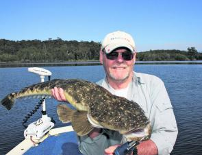 John Cathor with a thumping 93cm flattie from Tuross Lake, released to make baby flatties.