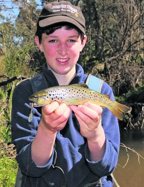 Will O'connor with a nice brown trout caught in a tributary of the Kiewa River earlier in the season. Trout are a very fast growing species of fish, and if this fish is still in the system by the start of next season it will most likely be over 40cm long.