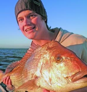Big red is out of bed – Mick Sewell proudly displays an early season snapper of 5.5kg from the Outer artificial off Carrum.