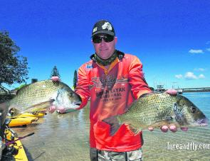 Jason Reid with two of the kicker fish from his winning Forster bag.