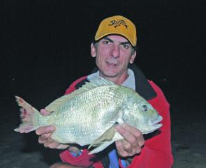 The author with a bulky 1.85 kilo bream caught while fishing for jewfish off the beach.