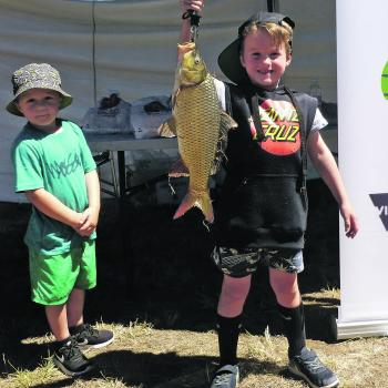 "Xavier heaves a carp up for the camera he caught on the ""Come and Try Fishing Day"" at McLeod's Waterhole, Clifton Springs."