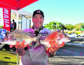 Ian Miller with two of his fish on day two that took him to his maiden Non-Boater Division win.