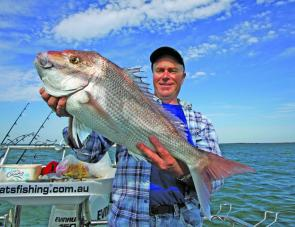 Eric Morgan from That's Fishing Productions with the winning fish for the 2010 Tea Tree Snapper Competition.