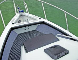 There's a lot of attention to detail with in the craft: The non skid material around the anchor well, plush side lining and deep carpet, side coaming and well-made front cushion on the cabin.
