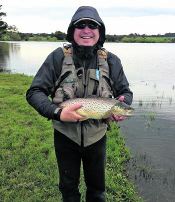 Andrew Pastuszka from the Mornington Peninsula Fly Fishers Club with a magnificent 1.94kg brown trout caught fly fishing from Newlyn Reservoir on a Bibio Hopper fly pattern.