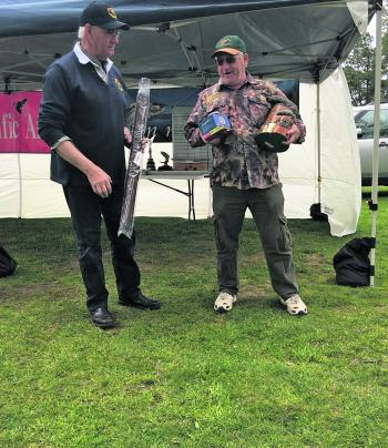 Ballarat Fly Fishers Club President Greg Armstrong presenting the 2016 Wastell Trophy to winner Ross Machar from the Yarra Valley Fishing Club.