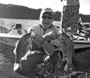 An excited Tim Morgan with two Lake Monduran bass.