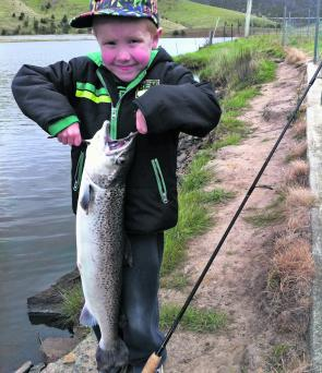 Toby Causby aged five with a 7lb Atlantic salmon at Craigbourne Dam caught on a Pumpkinseed Gulp Turtleback Worm