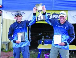 Team Cranka of Steve Steer and Andrew Cox lift the championship cup after snatching victory on the Derwent River with a 10/10 bag weighing 13.775kg.