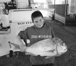 Jake Walsh proudly shows off this thumping 'big red', which weighed around 10kg. He caught it outside McLoughlins on a salmon fillet. Jake and his dad Brian have had great results on huge snapper and gummy sharks over the past month.