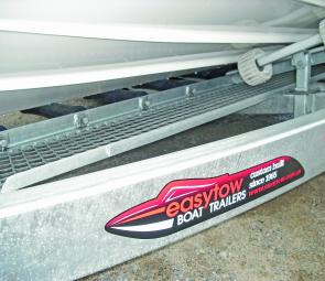 Easytow Trailers provide solid keel support with side rollers for stability.