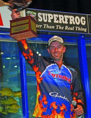 Steve Eldred holds aloft the Aussea Resources Trophy for his victory in the Mercury Gold Coast BREAM Super Series.