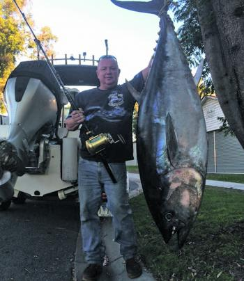 Luke Morris with his 113kg tuna that he caught fishing out off Cape Conran.