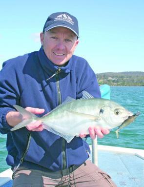 Ross with a kilo-plus trevally from the Top Lake at Merimbula caught on a larger soft plastic aimed at big flathead.