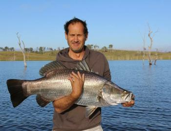 Simon Coker with his 98cm barra PB.
