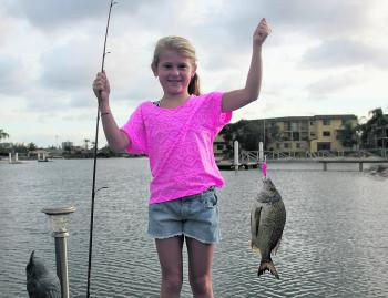 Lily with her first bream she caught off a jetty.