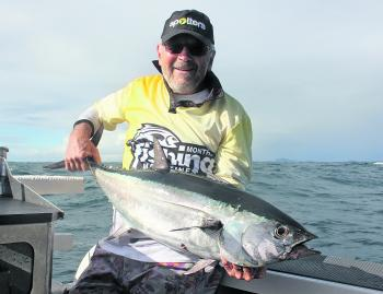 Godfrey with a nice longtail tuna.