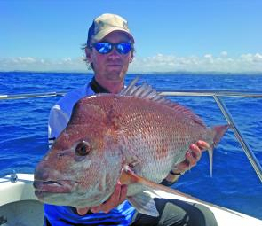 Mark Ashton with a fine snapper. Drifting the reef drop-offs casting soft plastics or lightly weighted baits has produced excellent results recently.