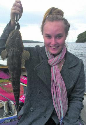 Sarah Ashley showed up the boys by bouncing a Gulp lure across rough bottom for a nice plate-size flathead.