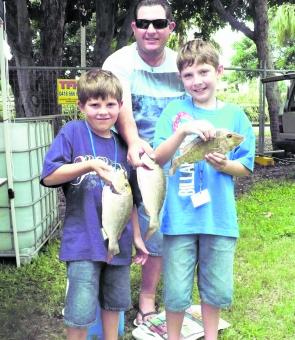 Joshua, Paul and Conner Limbrick with their catch of coral bream. Connor's fish was later selected for a daily prize.