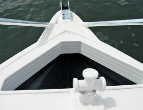 The Trident's split bow rail facilitates forward entry and exit and easy anchoring.